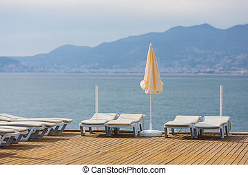 Before the holiday season - Deck chairs and umbrellas before...