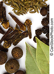 bay leaves, cloves and black pepper - cooking herbs. bay...