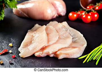 Fresh and raw meat. Chicken breast fillets cut ready for...