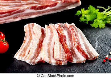Fresh and raw meat. Still life of bacon BBQ steaks.