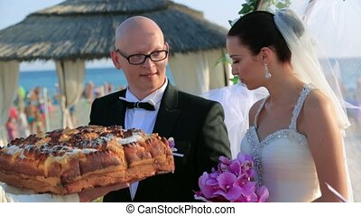 Happy Newlyweds Snap Off a Piece of Wedding Loaf - Happy...