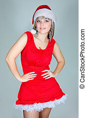 studio shot of beautiful santa girl