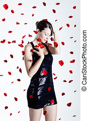 Rose petals woman - Beautiful and sexy fashion model posing...