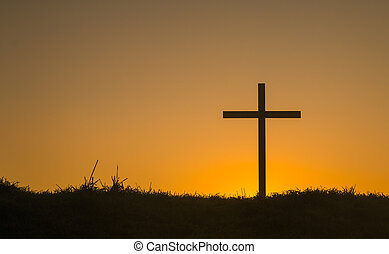 First Light Cross - Cross on hill with the first light of...