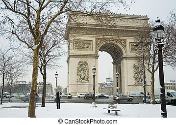 Rare snowy day in Paris Arc de Triomphe and lots of snow