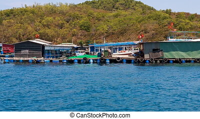 view of vietnamese houses on rafts against hills - panorama...