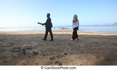 blonde guitarist discovers chasing girl and leaves beach at sunrise
