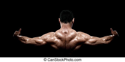 Rear view of healthy muscular young man with his arms...