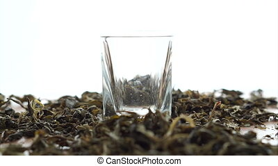 Dried Tea leaf filling in glass - Dried Tea leaf filling in...