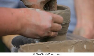 Women's hands making ceramic cup on potter's wheel - Woman...