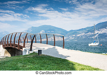 Bridge at Lake Garda - Bridge at the water front of Lake...