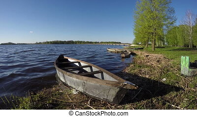 old wooden fishing boats on lake