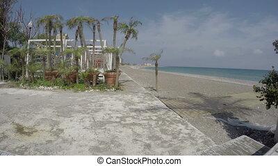 Empty Mediterranean sea beach in Rhodes town near casino....