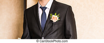 man in a suit with boutonniere