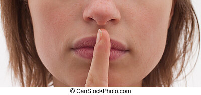 Shh - Cut out of woman with finger to lips - Saying Shh -...