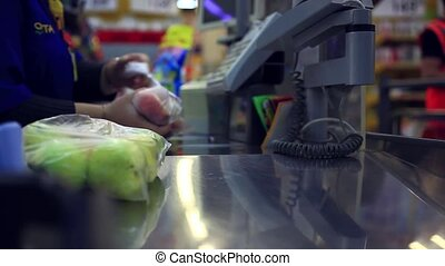 hands cashier check out goods line at the supermarket...
