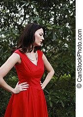 Beautiful woman wearing a red dress