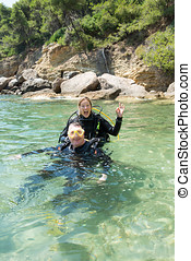 Happy scuba Divers - Male and female scuba divers have fun...