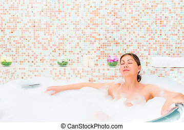 girl enjoying Jacuzzi in a romantic atmosphere