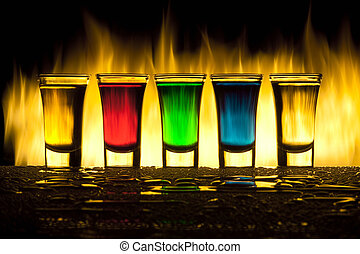 Glass with alcohol against fire with reflexion - Five colour...
