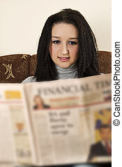 Smiling young woman read the news