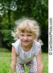 blond girl on grass