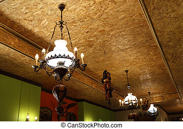 vintage chandelier shining and hanging from the ceiling