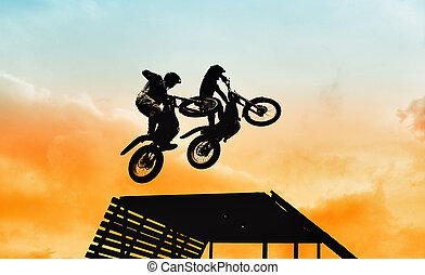 acrobatic jump with motorbike