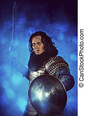 braveness - Ancient male warrior in armor holding sword....