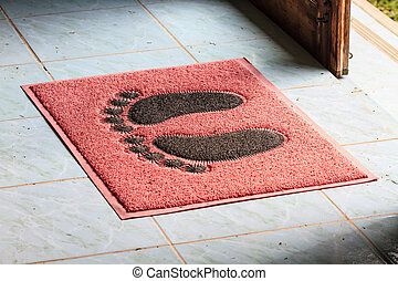 foot on floor mat with - foot on doormat with open door...
