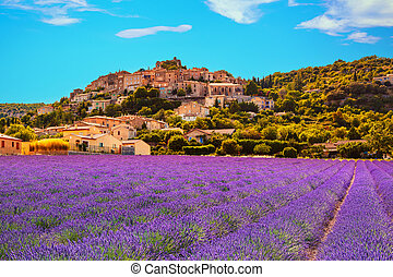Simiane la Rotonde village and lavender. Provence, France,...
