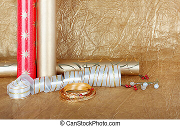 Rolls of multicolored wrapping paper with streamer for gifts...