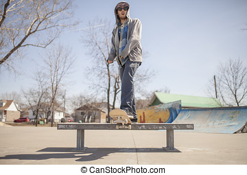 Young skateboard enthusiast in skatepark during day time