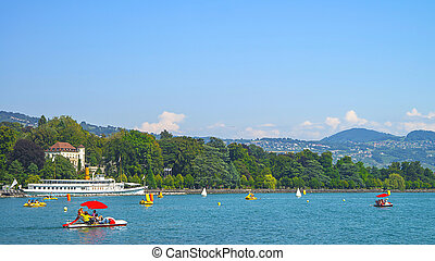 Red catamaranas and other water transport in Geneva Lake in...