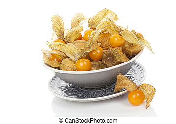 Physalis, groundcherries in bowl isolated on white...