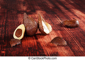 Salak fruit background - Delicious salak fruit on brown...