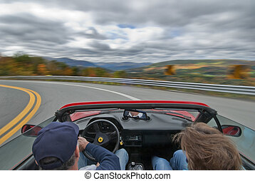 Speed driving - driving an italian sportscar at speed on a...