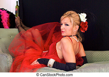 laying back on elbows - Beautiful blonde laying on chaise...