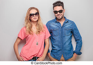 Smiling young casual couple looking at the camera