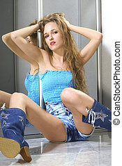 sexy woman in blue boots - young beautiful sexy woman sits...