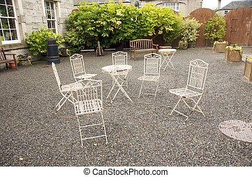 six oxide metal chairs - six old oxide metal chairs at a...