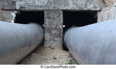 plastic heating pipes in trench - two black plastic central...