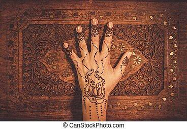 Womans hand with traditional menhdi henna ornament
