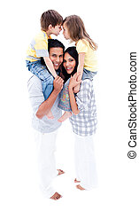 Lively family having fun together against a white background