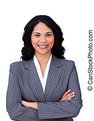 Portrait of a smiling businesswoman with folded arms against...