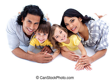 Lively family lying on the floor against a white background
