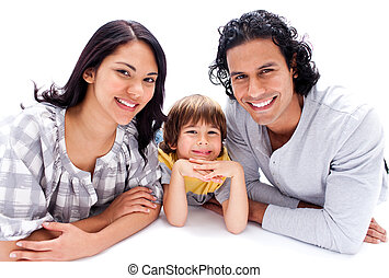 Happy little boy lying on the floor with his parents