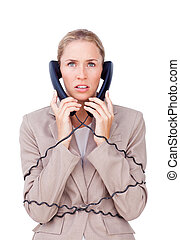 Stressed businesswoman trangled up in telephone wires