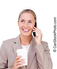 Smiling businesswoman on phone and drinking a coffee