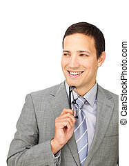 Self-assured businessman holding glasses against a white...